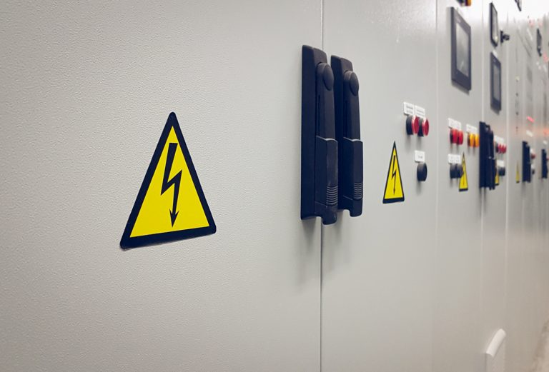 Sign dangerous voltage on the electrical panel.